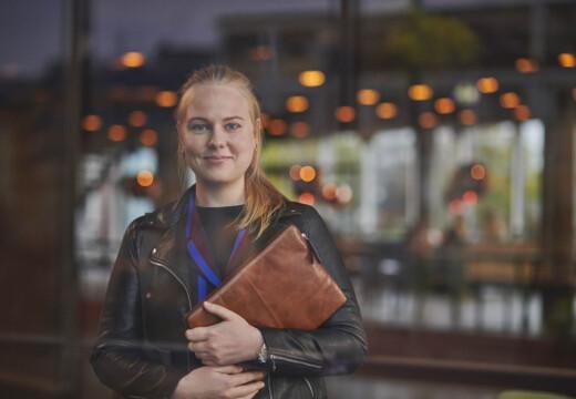 student at university college copenhagen holding a bag