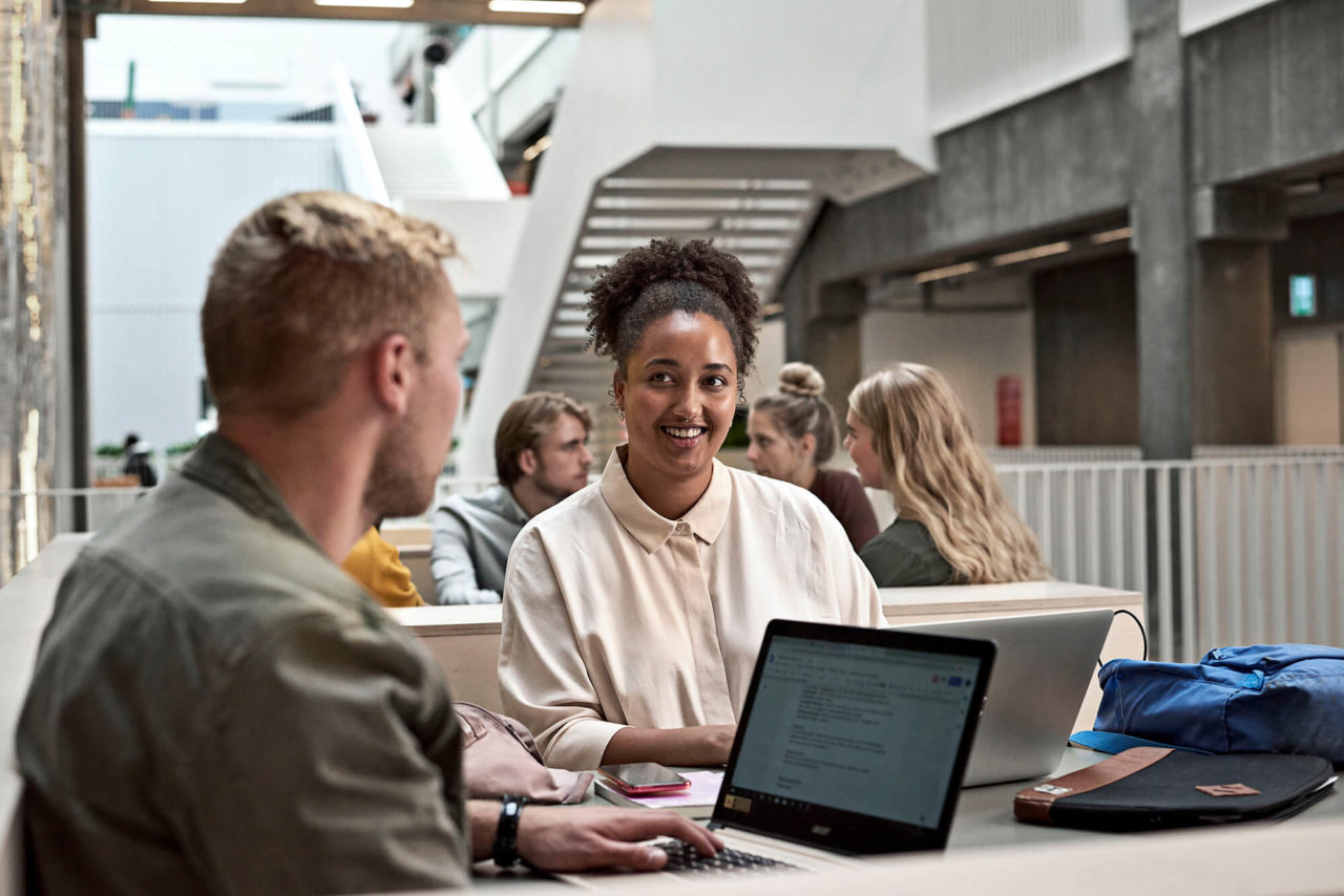 Male and female Teacher Education students working with computers at Campus Carlsberg