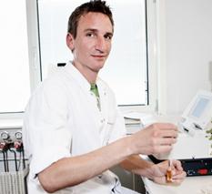 Laborant med kittel